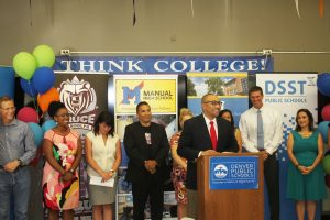 DPS school and district leaders celebrate academic progress on this year's Colorado Measures of Academic Success (CMAS) during an event Thursday, Aug. 17, at the Manual High School complex. Above, Manual Principal Nicholas Dawkins speaks from the podium.